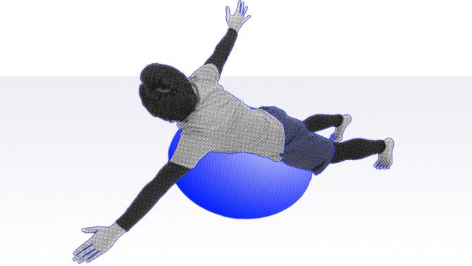 バランスボールの上でうつ伏せになり上半身を捻る運動